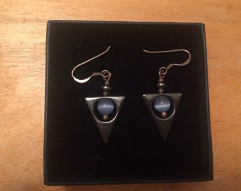 Silver triangular earrings with blue stones
