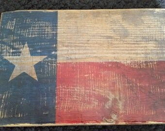 Texas flag on piece of wood