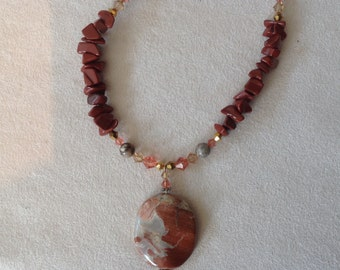 Necklace of Red Jasper and swarovski crystals salmon and amber, with grey and Red Jasper pendant.