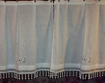 A pair of curtains made in fabrics and old lace