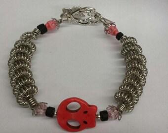 Chain coiled skull bracelet