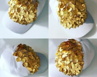 gold leaves white hat