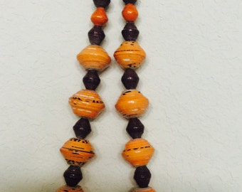 This item is made of polished paper beads of varying sizes. The necklace willMake you stand out in the crowd. Love it