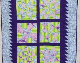 "Blue/Purple/Lime Pinwheel Quilt - Baby/Toddler  44"" x 57"" (Lime wavy lines, light purple batik, solid dark purple jigsaw border)"