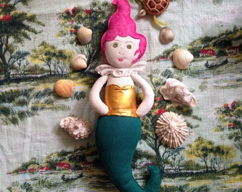 Pink haired mermaid doll