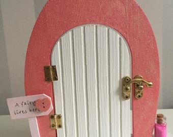 Beautiful pink glittery hand-painted wooden fairy door