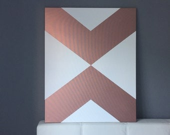 Rosé gold, geometric arrows on screen