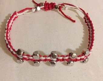 Red and white bracelet with silver beads
