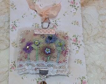 lavender filled lace pendant