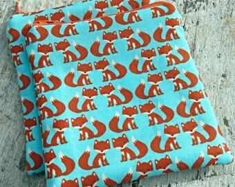 Blue little foxes square zipper pouch