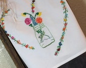 Hand Embroidered Flour Sack Towel embroidered with a Jar filled with Flowers insideWith the word Ball embroidered on the towel