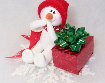 Giggles the Snowman ornament with his gift package
