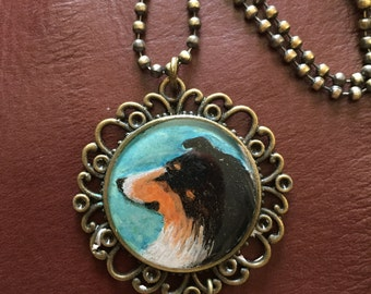 Sheltie/Collie polymer clay pendant by Darbella