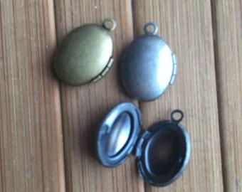 Oval tiny plain locket 13x10mm - Code 296.695