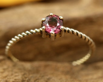 Pink spinel ring round faceted in prongs setting with sterling silver twist band