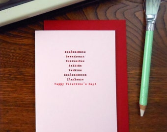 letterpress edited valentine greeting card happy valentine's day typewriter correction red & black ink on pink paper