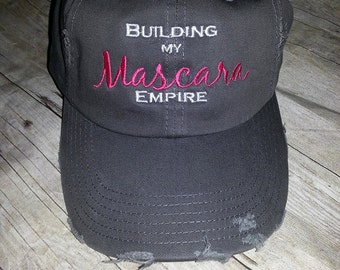 Nickel gray colored distressed hat embroidered with Building my mascara empire