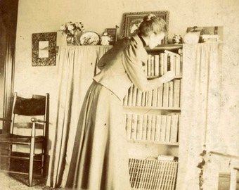 Vintage photo 1900 Unusual Tall Woman From Back REaches for Book Library Bookshelf cabinet