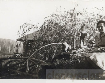 vintage photo Lady Sits by Garden Gnome & SPitting Frog Pond