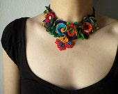 freeform crochet statement necklace with red, pink, blue, and green crocheted flowers - Adonis Aestivalis