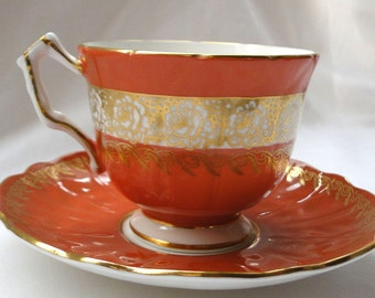 Beautiful vintage Aynsley teacup and saucer Gold and Sienna