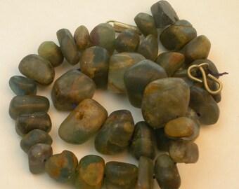 Fluorite nuggets, dark blue-green strand