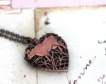cow. heart locket necklace. in copper ox with floral filigree jewelry