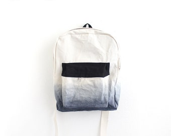Dark grey dyed backpack with black pouch