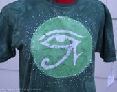 Green Eye of Horus Big Kids Batik T-Shirt. Size Youth X-Large. Short Sleeve. Dyed and Drawn by Hand. Original Art Clothing. Egyptian Shirt