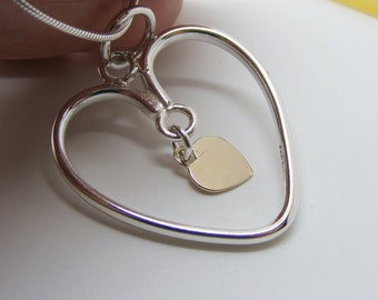 Silver and Gold Moving heart pendant, handmade heart jewelry, Fluid by design