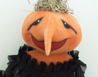 Pumpkin head doll