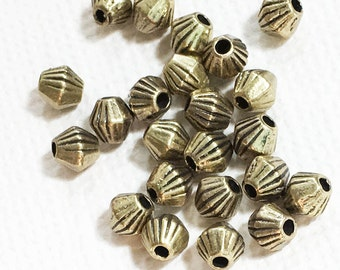 50 antique brass finished bicone spacer beads 4x3.5mm,  metal spacer beads