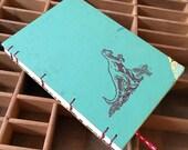 letterpress dinosaur datebook with vintage book cover