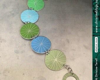 Reversible Starburst Bracelet--Upcycled Tin