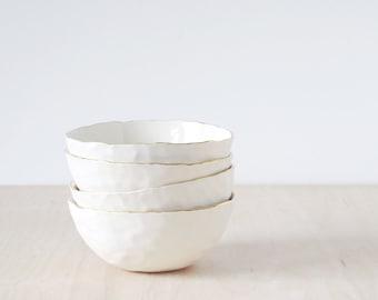 gold rimmed, porcelain dessert bowl.