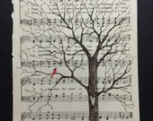 tree ink drawing on vintage hymnal page with special cardinal visitor