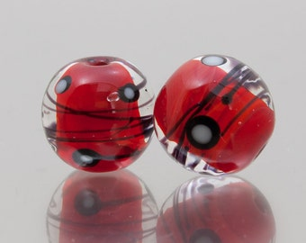 Lampwork glass beads - Comet Trails in red, black and white. Lampwork glass beads by Jennie Yip