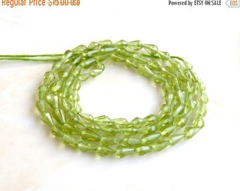 Mega SALE Peridot Gemstone Briolette Faceted 3-D Tear Drop Green Center Drilled 4 to 5mm 32 beads