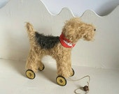 Reserved for Cheryl Little Terrier on vintage Meccano wheels