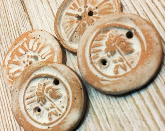 Four Primitive Stoneware Buttons  Indian Head and Floral Designs