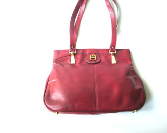 Classy vintage 70s burgundy genuine leather , large, shoulder, hand bag with a two top handles. Made by Etienne Aigner.