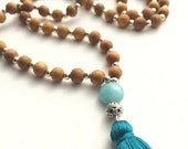 sandalwood mala woth aqua stone and silk tassel
