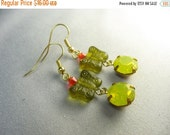 wild butterfly earrings ... green glass earrings with large vintage rhinestone charms and tiny red crystals