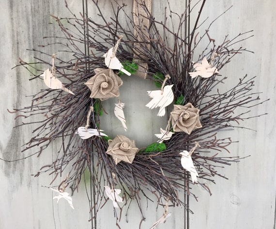 Twig wreath with Bird silhouettes cut out of by