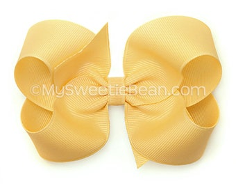 Lemonade Hair Bow, Pale Gold 4 inch Boutique Bow, Grosgrain Bow for Girls, No Slip Hairbow for Baby, Toddler Girls, Light Gold, Pale Yellow