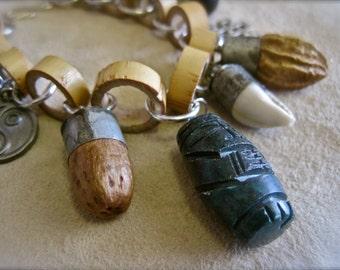 Voodoo Vixen: AMULET CHARM Bracelet Vintage Assemblage Festival Tribal Bamboo Links Talismans Carved Malachite Tiki Figures Shell Seeds