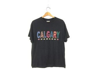 Canada Calgary T-Shirt Oversized Black T Shirt Canadian Travel Tee Souvenir Novelty Baggy Tshirt Unisex Coed Size Large Dells