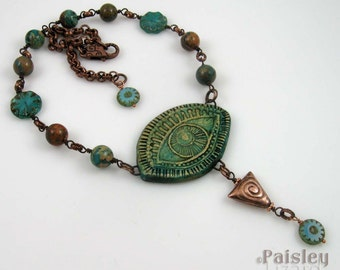 Green Evil Eye necklace, polymer clay pendant with glass, gemstone, copper beads