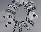 a set of 13 black white and clear graduated disks all in different designs handmade lampwork beads - Back to Basics