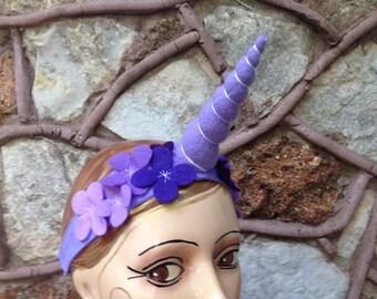 Purple unicorn horn headband with felt flowers